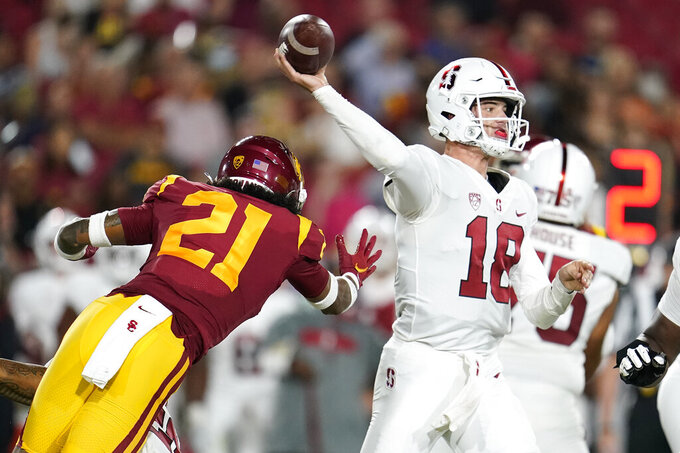 Stanford quarterback Tanner McKee (18) throws past Southern California safety Isaiah Pola-Mao (21) during the first half of an NCAA college football game Saturday, Sept. 11, 2021, in Los Angeles. (AP Photo/Marcio Jose Sanchez)