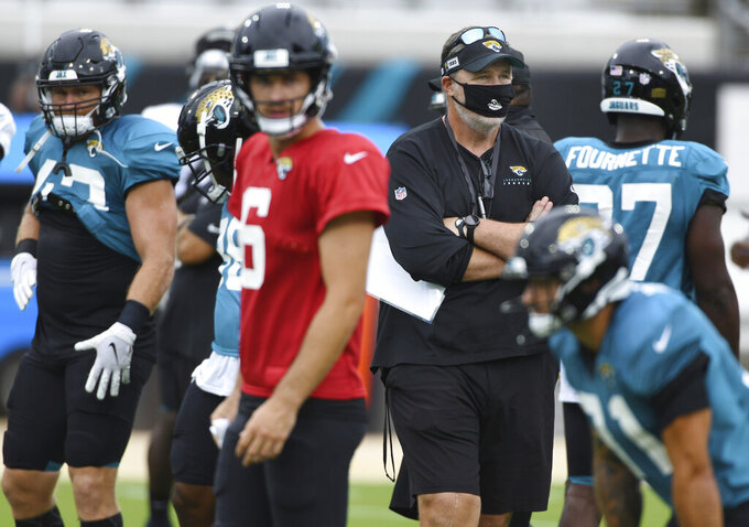 Jacksonville Jaguars head coach Doug Marrone watches during NFL football training camp, Saturday, Aug. 29, 2020, in Jacksonville, Fla. (Bob Self/The Florida Times-Union via AP)