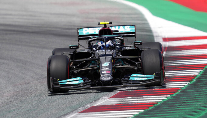 Mercedes driver Valtteri Bottas of Finland steers his car during the qualifying at the Red Bull Ring racetrack in Spielberg, Austria, Saturday, June 26, 2021. The Styrian Formula One Grand Prix will be held on Sunday, June 27, 2021. (AP Photo/Darko Vojinovic)
