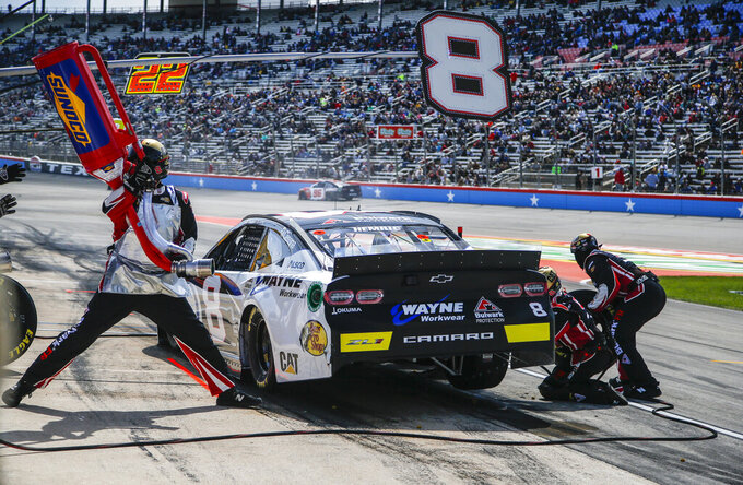 Driver Daniel Hemric's pit crew service his car during a NASCAR Cup auto race at Texas Motor Speedway, Sunday, March 31, 2019, in Fort Worth, Texas. (AP Photo/Brandon Wade)
