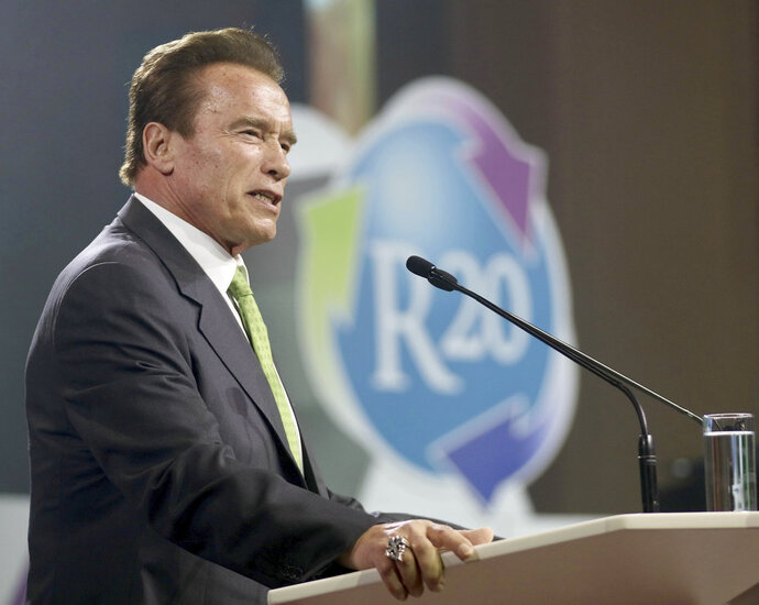 """FILE - In this May 15, 2018 file photo, Arnold Schwarzenegger delivers a speech during the R20 Austrian world summit at the Hofburg palace Vienna, Austria. Schwarzenegger said he """"stepped over the line several times"""" with women. In an interview released Tuesday, Oct. 9 in Men's Health, the actor and former Republican governor of California said he was the """"first one to say sorry.""""   Schwarzenegger said he feels bad about it and apologies.(AP Photo/Ronald Zak, File)"""