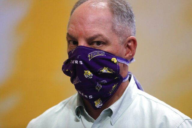 Louisiana Gov. John Bel Edwards wears a face mask as he visits a production site on the LSU campus in Baton Rouge, La., where the school is manufacturing personal protection equipment for hospitals in response to the coronavirus pandemic Friday, April 17, 2020. (AP Photo/Gerald Herbert)