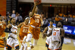 Texas guard Donovan Williams (10) drives the lane during the first half of the NCAA college basketball game against Oklahoma State in Stillwater, Okla., Saturday, Feb. 6, 2021. (AP Photo/Mitch Alcala)