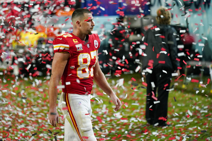 Kansas City Chiefs tight end Travis Kelce walks off the field after losing to the Tampa Bay Buccaneers of the NFL Super Bowl 55 football game Sunday, Feb. 7, 2021, in Tampa, Fla. The Buccaneers defeated the Chiefs 31-9 to win the Super Bowl. (AP Photo/David J. Phillip)