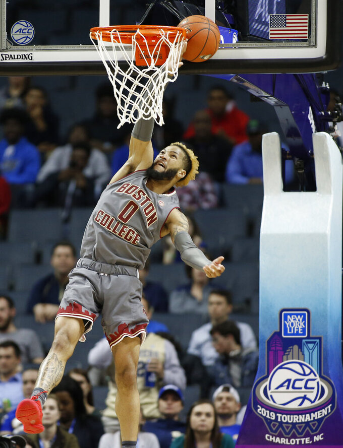 Boston College's Ky Bowman misses a dunk as the ball gets stuck between the rim and the backboard during the first half of the team's NCAA college basketball game against Pittsburgh in the Atlantic Coast Conference men's tournament in Charlotte, N.C., Tuesday, March 12, 2019. (AP Photo/Nell Redmond)