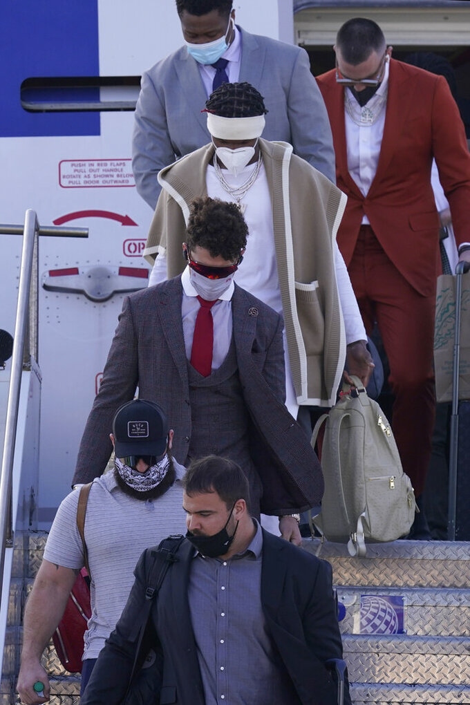 Kansas City Chiefs quarterback Patrick Mahomes, center, arrives with teammates for the NFL Super Bowl 55 football game against the Tampa Bay Buccaneers, Saturday, Feb. 6, 2021, in Tampa, Fla. (AP Photo/Charlie Riedel)