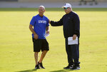 Dallas Cowboys head coach Mike McCarthy, right, and offensive line coach Joe Philbin watch team practice during an NFL football training camp in Frisco, Texas, Friday, Aug. 14, 2020. (AP Photo/LM Otero)