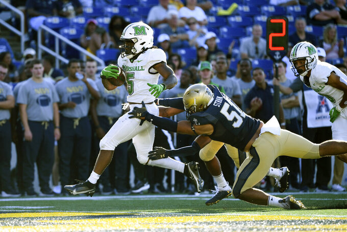 Marshall running back Sheldon Evans (5) runs the ball for a touchdown during the second half of an NCAA college football game against Navy, Saturday, Sept. 4, 2021, in Annapolis, Md. (AP Photo/Terrance Williams)