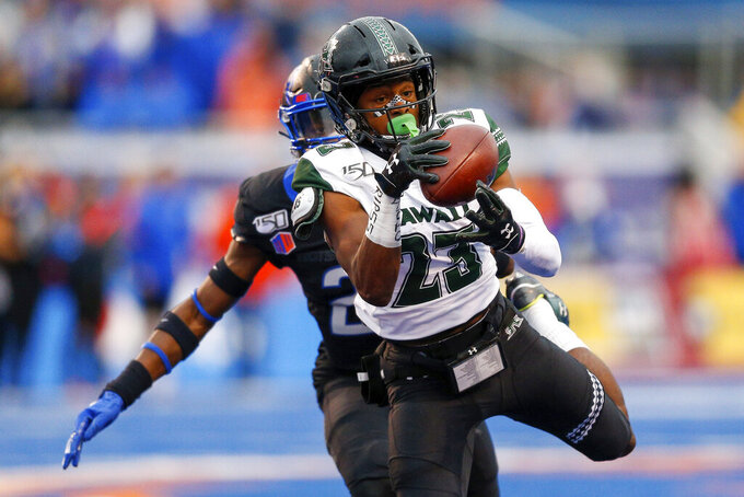 Hawaii wide receiver Jared Smart (23) catches the ball for a 46 yard reception against Boise State during the second half of an NCAA college football game for the Mountain West Championship Saturday, Dec. 7, 2019, in Boise, Idaho. Boise State won 31-10. (AP Photo/Steve Conner)