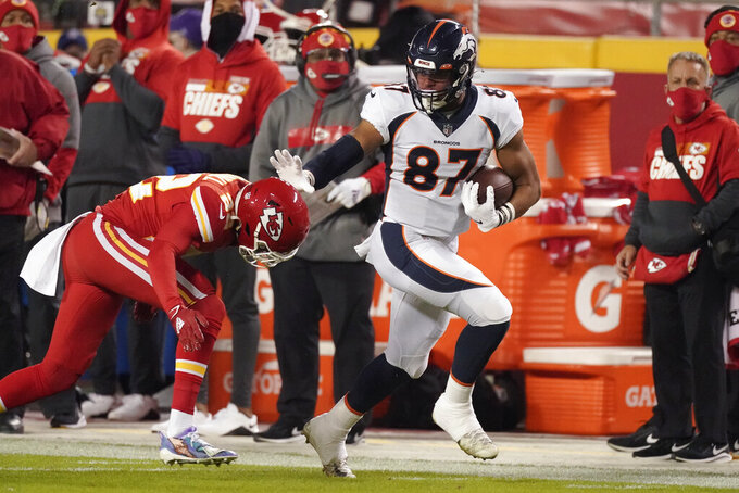 Denver Broncos tight end Noah Fant (87) tries to avoid Kansas City Chiefs free safety Juan Thornhill (22) in the first half of an NFL football game in Kansas City, Mo., Sunday, Dec. 6, 2020. (AP Photo/Charlie Riedel )