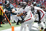 Philadelphia Eagles tight end Dallas Goedert (88) is held out of gthe end zone after a catch against the Atlanta Falcons during the first half of an NFL football game, Sunday, Sept. 12, 2021, in Atlanta. (AP Photo/John Bazemore)