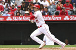 Los Angeles Angels designated hitter Shohei Ohtani hits a single in the sixth inning of a baseball game against the Seattle Mariners, Sunday, Sept. 26, 2021, in Anaheim, Calif. The Mariners won 5-1. (AP Photo/Michael Owen Baker)