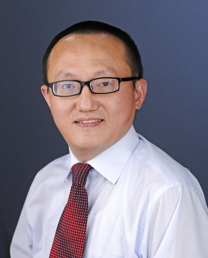 FILE- This undated file photo provided by the University of Kansas shows researcher Franklin Feng Tao. Tao, of Lawrence, Kansas, was indicted last year for not disclosing on conflict-of-interest forms work he was allegedly doing for China while employed at the University of Kansas. Defense attorneys, on Friday, Aug. 14, 2020,  have filed a motion seeking to throw out the charges. (Kelsey Kimberlin/University of Kansas via AP, File)