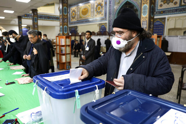 A voter casts his ballot in the parliamentary elections in a polling station in Tehran, Iran, Friday, Feb. 21, 2020. Iranians began voting for a new parliament Friday, with turnout seen as a key measure of support for Iran's leadership as sanctions weigh on the economy and isolate the country diplomatically. (AP Photo/Vahid Salemi)