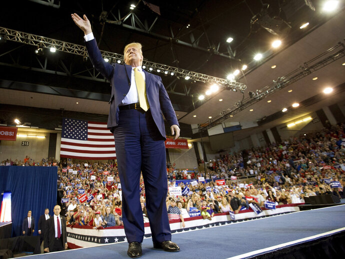 President Donald Trump speaks during his Keep America Great Rally at the Civic Center in Lake Charles, La., Friday, Oct. 11, 2019. (Rick Hickman/American Press via AP)