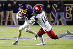 East Carolina's Blake Proehl (11) tries to break away from Cincinnati's Cam Jefferies (14) during the first half of an NCAA college football game in Greenville, N.C., Saturday, Nov. 2, 2019. (AP Photo/Karl B DeBlaker)
