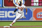 Baltimore Orioles' Trey Mancini rounds second on his way to a third on a triple against the Toronto Blue Jays during the first inning of a baseball game Wednesday, June 12, 2019, in Baltimore. (AP Photo/Gail Burton)