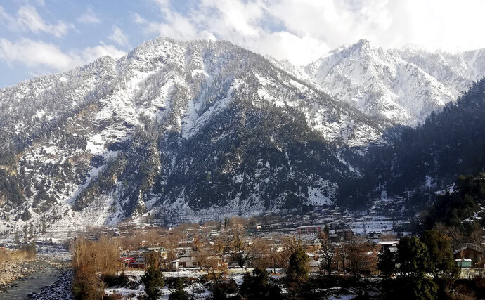 Snow covers areas of Kundalshahi, in Neelum Valley, Pakistan-administered Kashmir, Tuesday, Jan. 14, 2020. Severe winter weather has claimed more lives as avalanches triggered by heavy snowfall killed more than 50 people in Pakistan-administered Kashmir while a dozen died in neighboring Afghanistan, officials said Tuesday. (AP Photo/M.D. Mughal)