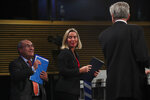 European Union Foreign Policy chief Federica Mogherini, center, UN High Commissioner for Refugees Filipo Grandi, right, and UN Migration Agency Director General Antonio Vitorino leave at the end of a joint news conference at the EU headquarters in Brussels, Tuesday, Oct. 29, 2019. The European Union says a