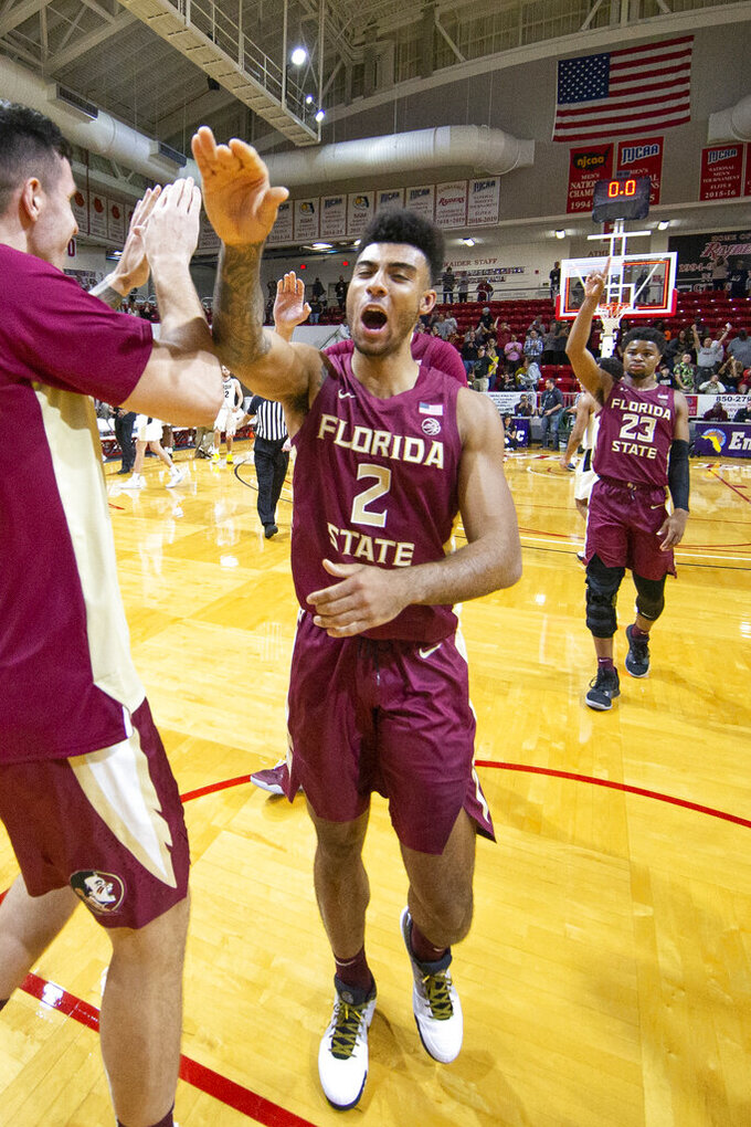 Florida State guard Anthony Polite (2) celebrates the 63-60 victory over Purdue in overtime of an NCAA college basketball game at the Emerald Coast Classic in Niceville, Fla., Saturday, Nov. 30, 2019. (AP Photo/Mark Wallheiser)
