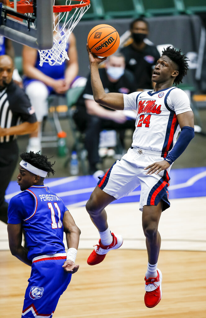 Mississippi guard Jarkel Joiner (24) lays up the ball as Louisiana Tech guard JaColby Pemberton (11) defends during the first half of an NCAA college basketball game in the NIT, Friday, March 19, 2021, in Frisco, Texas. (AP Photo/Brandon Wade)
