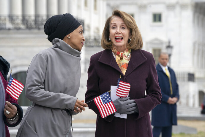 Rep. Ilhan Omar, D-Minn., left, joins Speaker of the House Nancy Pelosi, D-Calif., as Democrats rally outside the Capitol ahead of passage of H.R. 1,