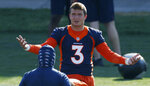 Denver Broncos quarterback Drew Lock takes part in drills during NFL football practice at the team's headquarters Wednesday, Aug. 19, 2020, in Englewood, Colo. (AP Photo/David Zalubowski)