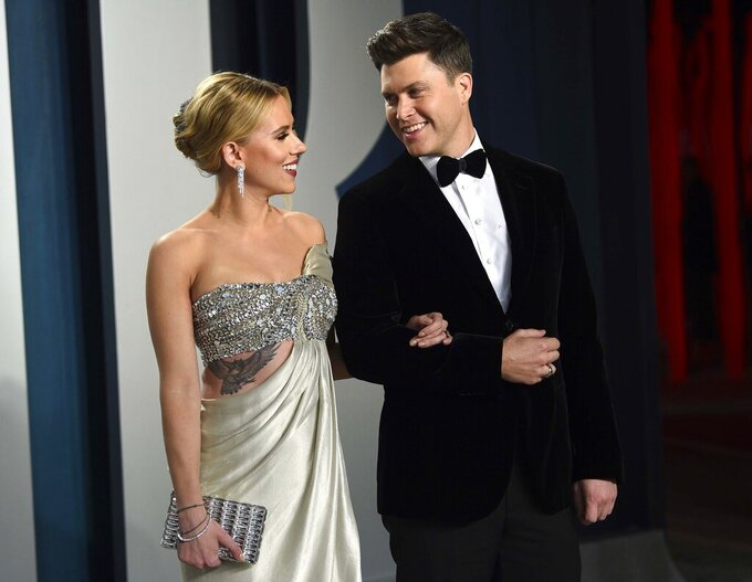 """FILE - In this Feb. 9, 2020 file photo, Scarlett Johansson, left, and Colin Jost arrive at the Vanity Fair Oscar Party in Beverly Hills, Calif. Johansson is a mom to two now. The """"Black Widow"""" star recently gave birth to a son, Cosmo, with husband Colin Jost, the """"Saturday Night Live"""" star said on Instagram Wednesday, Aug. 18, 2021. This is the first child for the couple, who were married last October. (Photo by Evan Agostini/Invision/AP, File)"""