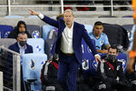 Minnesota United coach Adrian Heath directs his team against the Houston Dynamo during the second half of an MLS soccer match, Saturday, Sept. 25, 2021, in St. Paul, Minn. (AP Photo/Andy Clayton-King)