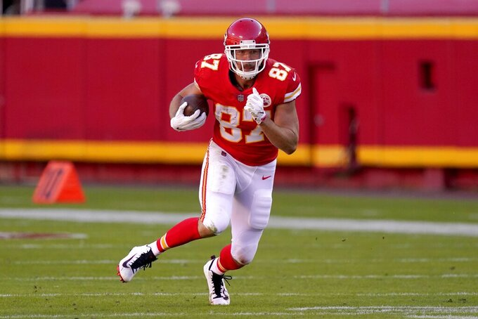 Kansas City Chiefs tight end Travis Kelce (87) finds running room after catching a pass in the second half of an NFL football game against the New York Jets on Sunday, Nov. 1, 2020, in Kansas City, Mo. (AP Photo/Charlie Riedel)