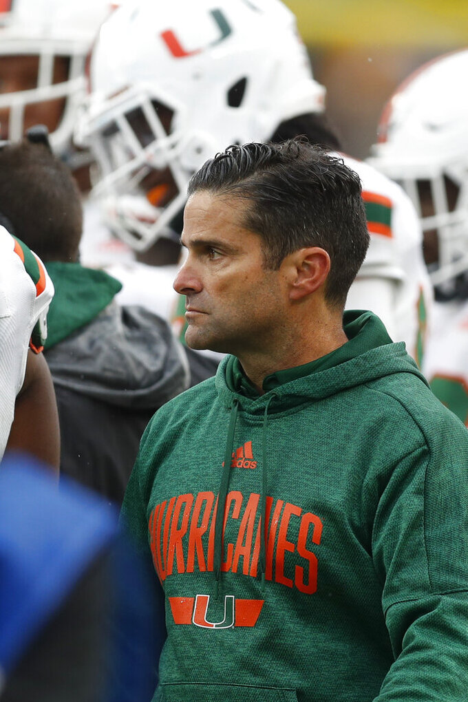 Miami head coach Manny Diaz watches from the sideline as his team plays against Pittsburgh during the second half of an NCAA college football game, Saturday, Oct. 26, 2019, in Pittsburgh. Miami won 16-12. (AP Photo/Keith Srakocic)