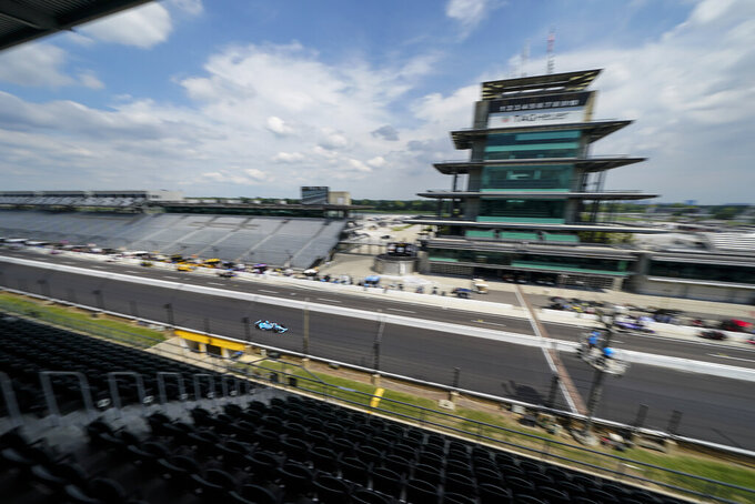 Max Chilton, of England, drives down the main straight-a-way during a practice session for the Indianapolis 500 auto race at Indianapolis Motor Speedway, Friday, Aug. 14, 2020, in Indianapolis. (AP Photo/Darron Cummings)