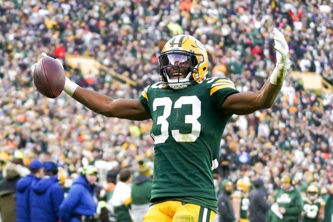 Aaron Jones, de los Packers de Green Bay, festeja tras un acarreo en el partido de la NFL frente a los Redskins de Washington, el domingo 8 de diciembre de 2019, en Green Bay, Wisconsin. (AP Foto/Morry Gash)