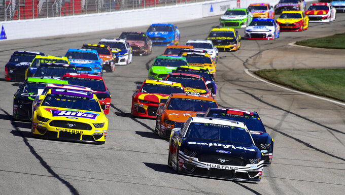 Aric Almirola leads off the start of a NASCAR Monster Energy NASCAR Cup Series auto race at Atlanta Motor Speedway, Sunday, Feb. 24, 2019, in Hampton, Ga. (AP Photo/Scott Cunningham)