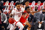 Texas Tech's Kyler Edwards (11) dribbles the ball past Sam Houston State's Bryce Monroe (0) during the first half of an NCAA college basketball game Friday, Nov. 27, 2020, in Lubbock, Texas. (AP Photo/Brad Tollefson)