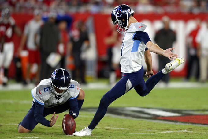FILE - In this Aug 21, 2021, file photo, Tennessee Titans' Sam Ficken, right, boots a field goal against the Tampa Bay Buccaneers as punter Brett Kern (6) holds during the first half of an NFL preseason football game in Tampa, Fla. Ficken has been added to the injury report with an injured groin and the Titans have signed Michael Badgley to the practice squad. Tennessee opens the season Sunday, Sept. 12, 2021, hosting Arizona. (AP Photo/Jason Behnken, File)