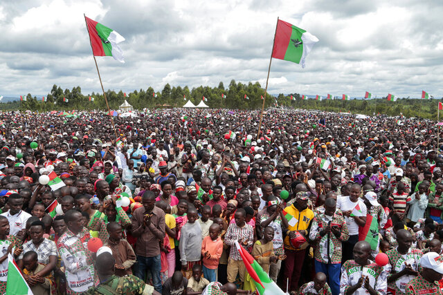 FILE - In this April 27, 2020, file photo, crowds of supporters of the ruling party gather for the start of the election campaign, in Bugendana, Gitega province, Burundi. Burundi is pushing ahead with an election in this month that will end President Pierre Nkurunziza's divisive and bloody 15-year rule but the coronavirus poses a threat to the May 20, 2020 vote which could be the first truly peaceful transfer of authority in the central African nation that has seen coups and ethnic fighting since independence in 1962. (AP Photo/Berthier Mugiraneza, File)