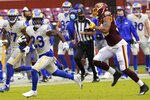 Los Angeles Rams' Cam Akers runs during the second half of an NFL football game against the Washington Football Team Sunday, Oct. 11, 2020, in Landover, Md. (AP Photo/Steve Helber)