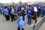 FILE - In this April 6, 2015, file photo, security wands fans before an opening day baseball game between the Chicago White Sox and Kansas City Royals at Kauffman Stadium in Kansas City, Mo. The metal detectors that greet sports fans at the gates might soon be accompanied by thermal body scanners, in the gargantuan task of better protecting venues from virus spread in order to bring the games back for in-person viewing.  (AP Photo/Orlin Wagner, File)