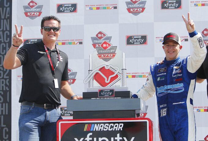 Car owner Matt Kaulig, left, celebrates with A.J. Allmendinger in Victory Lane after winning the B&L Transport 170 NASCAR Xfinity Series auto race at Mid-Ohio Sports Car Course on Saturday, June 5, 2021, in Lexington, Ohio. (AP Photo/Tom E. Puskar)
