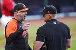 Baltimore Orioles manager Brandon Hyde, left, argues with home plate umpire Jim Wolf in the first inning of a baseball game against the Cleveland Indians, Monday, June 14, 2021, in Cleveland. (AP Photo/Tony Dejak)