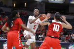 Maryland's Kaila Charles (5) puts up a shot against Ohio State's Janai Crooms (3) and Braxtin Miller (10) during the first half of an NCAA college basketball championship game at the Big Ten Conference tournament, Sunday, March 8, 2020, in Indianapolis. (AP Photo/Darron Cummings)