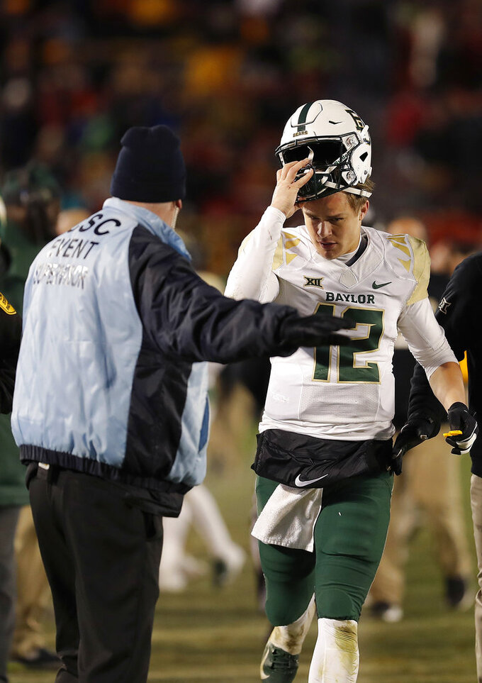 Baylor quarterback Charlie Brewer leaves the field after he was ejected during the second half of an NCAA college football game against Iows State, Saturday, Nov. 10, 2018, in Ames. Iowa. (AP Photo/Matthew Putney)