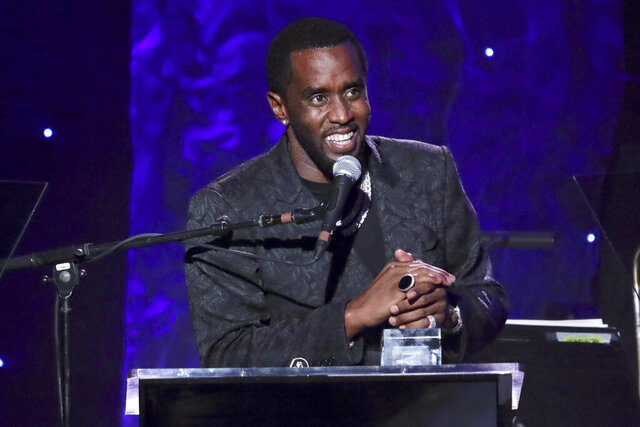 FILE - In this Jan. 25, 2020, file photo, Sean Combs accepts the 2020 Industry Icon award at the Pre-Grammy Gala And Salute To Industry Icons in Beverly Hills, Calif. Combs will be among a star-studded guest list for the Rock and Roll Hall of Fame 2020 induction. (Photo by Willy Sanjuan/Invision/AP, File)