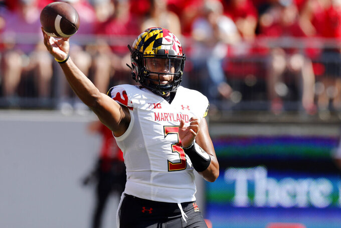 Maryland quarterback Taulia Tagovailoa throws a pass against Ohio State during the first half of an NCAA college football game Saturday, Oct. 9, 2021, in Columbus, Ohio. (AP Photo/Jay LaPrete)