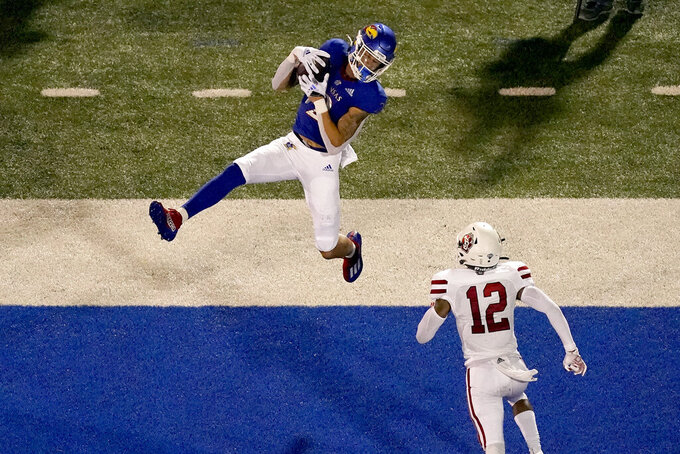 Kansas wide receiver Lawrence Arnold (2) catches a pass over South Dakota defensive back Tre Jackson (12) to score a touchdown during the first half of an NCAA college football game Friday, Sept. 3, 2021, in Lawrence, Kan. (AP Photo/Charlie Riedel)