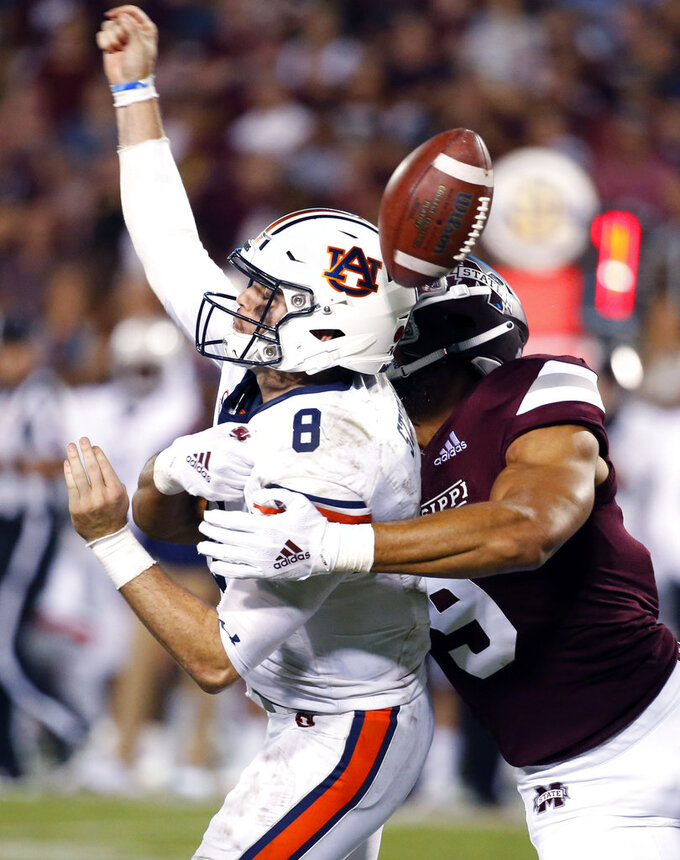 Mississippi State defensive end Montez Sweat (9) forces Auburn quarterback Jarrett Stidham (8) to fumble as he attempts to pass during the second half of their NCAA college football game in Starkville, Miss., Saturday, Oct. 6, 2018. Mississippi State won 23-9. (AP Photo/Rogelio V. Solis)