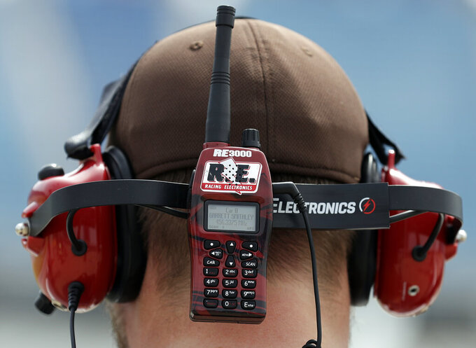A NASCAR fan listens to his radio as he watches a NASCAR Xfinity Series auto race practice at Chicagoland Speedway in Joliet, Ill., Friday, June 28, 2019. (AP Photo/Nam Y. Huh)