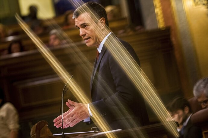 Spain's caretaker Prime Minister Pedro Sánchez gives a speech during the parliamentary debate at the Spanish parliament in Madrid, Spain, Monday, July 22, 2019. Sánchez will seek the endorsement of the Spanish Parliament on Monday ahead of this week's confidence votes for him to form a new government. (AP Photo/Bernat Armangue)