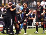 Atlanta United forward Josef Martinez (7) celebrates a goal against Inter Miami with teammates during the first half of an MLS soccer match, Sunday, May 9, 2021, in Fort Lauderdale, Fla. (AP Photo/Jim Rassol)